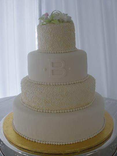 Four tier cake with edible pearls