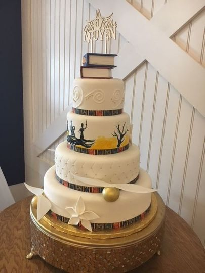 Book inspired four tier wedding cake