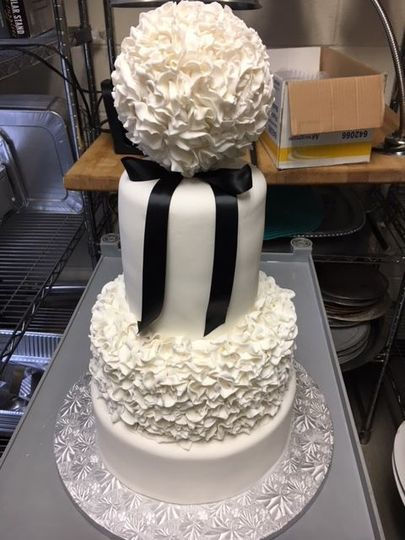 Four tier wedding cake with black ribbon