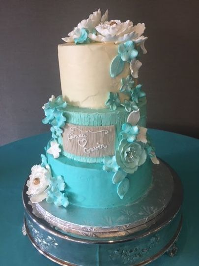 Three tier white and blue cake