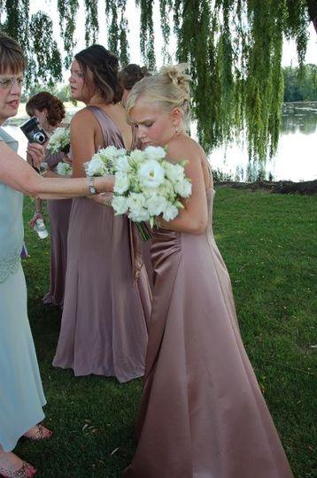 Jr. Bridesmaid with white lisianthus bouquet