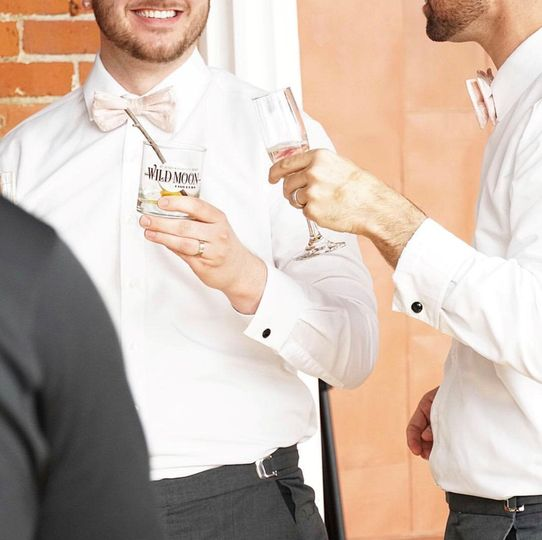 Groomsmen enjoying cocktails
