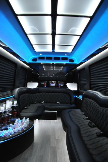 Interior of the Mercedes-Benz Sprinter. It features black leather wraparound seating for 12, wet...