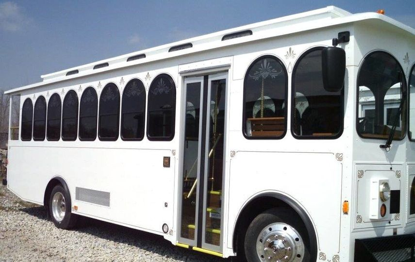 Our 28 Passenger Wedding Trolley comes complete with Surround Sound Satellite radio, sliding...