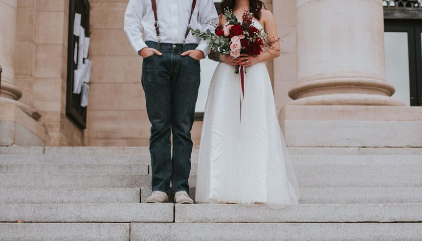 Creative shot of newlyweds by the stairs