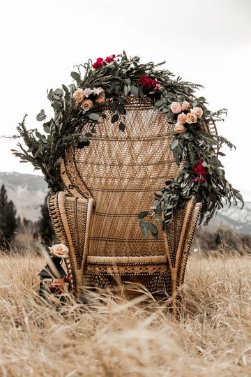 Floral decor over wooden chair