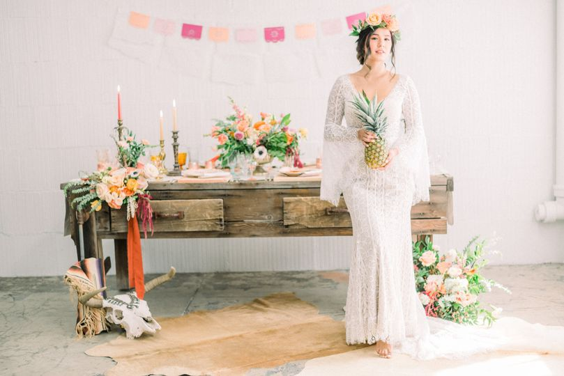 Bride by a table in flower decor