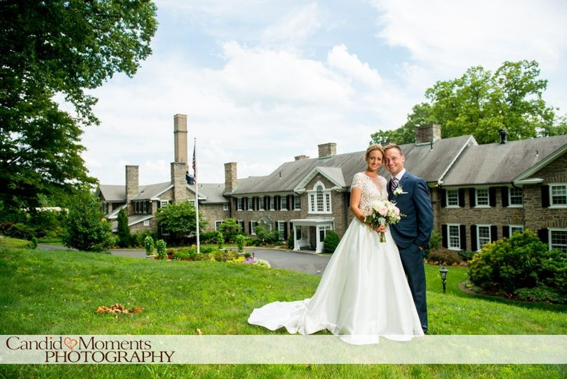 Couple in front of clubhouse