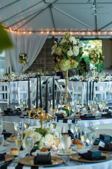 Tall gold candelabra and low gold candelabra centerpieces.