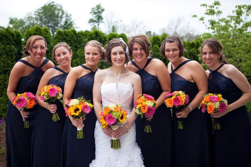 Bride and her bridesmaids' colorful bouquets
