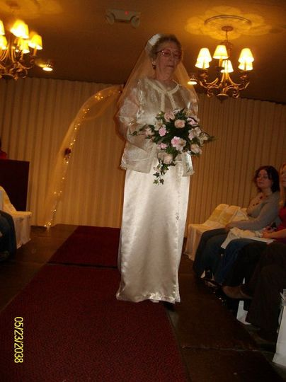 Ivory satin three piece wedding dress with pill box hat and veil