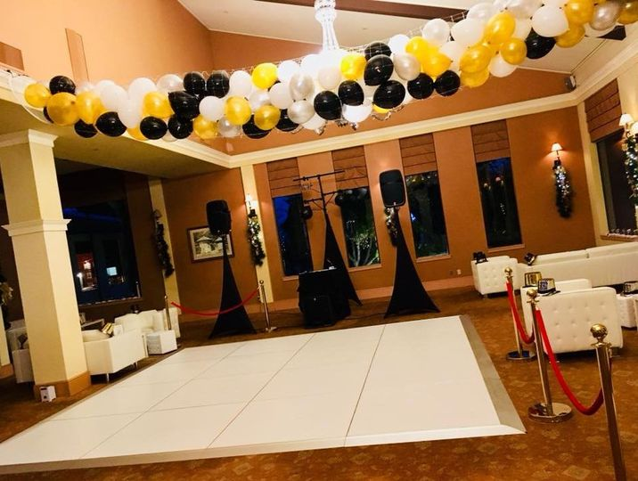 Black, yellow, and white ballons