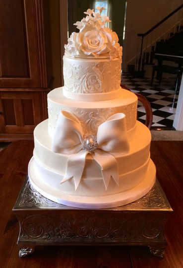 White cake with a big ribbon