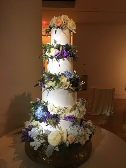 Tall cake with purple flowers