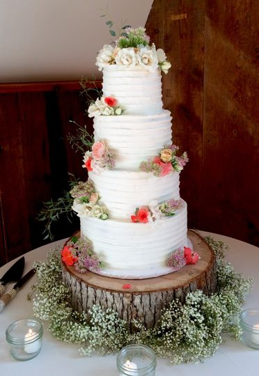 Four tier cake with edible flowers