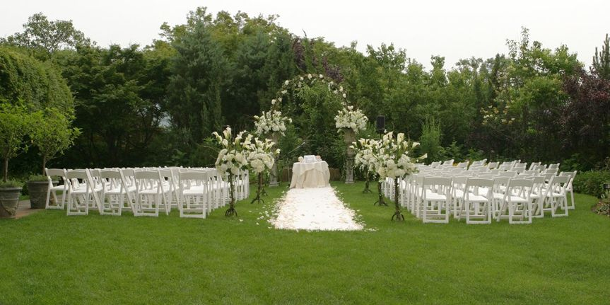Ceremony on the great lawn in the gardens