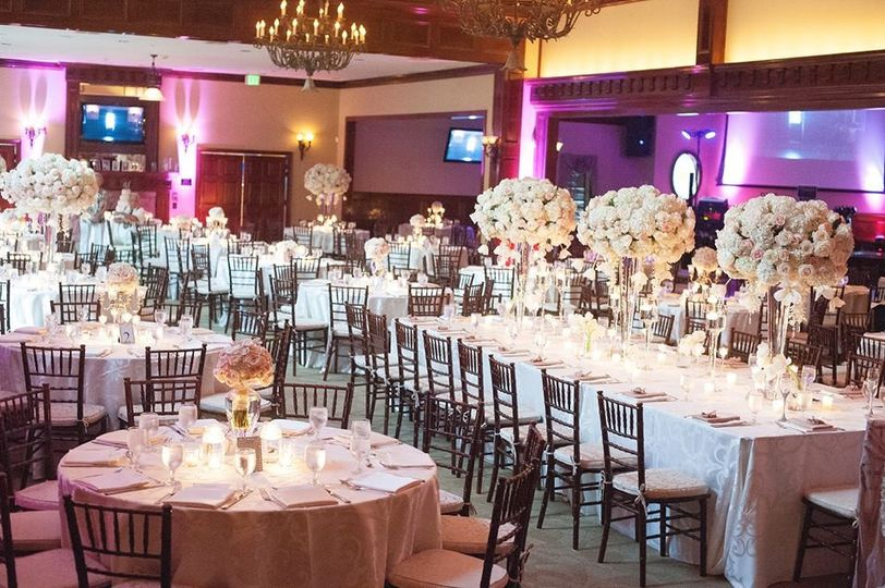Blush and cream reception with estate table.  Floral arrangements of hydrangeas, roses, tulips,...