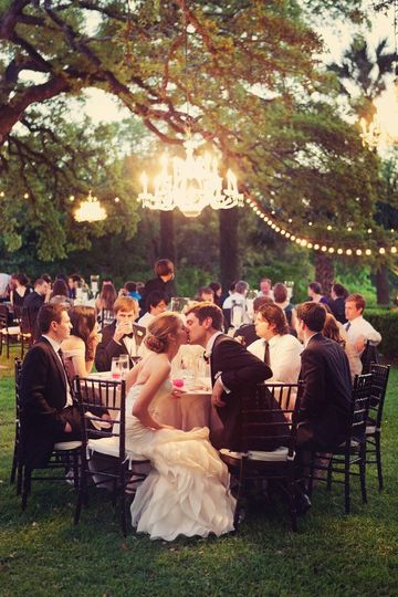 Hanging Chandeliers, Globe lights, streamers, candles and even Origami from the boughs of the trees...