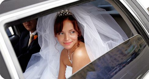 bride in wedding limousine