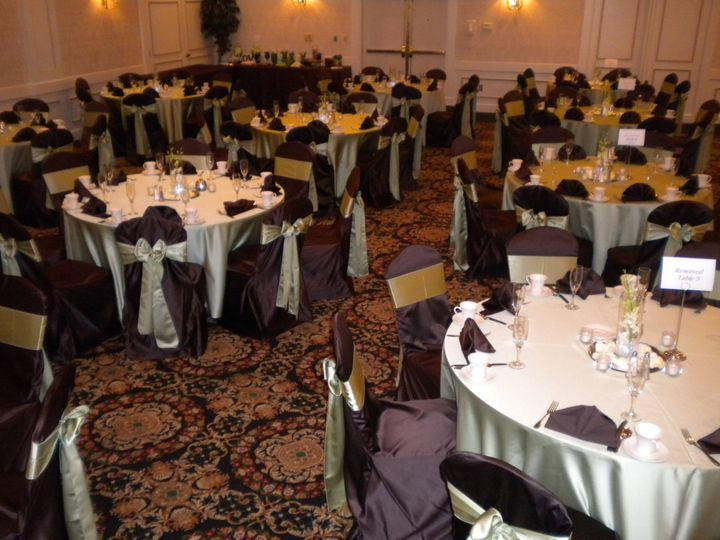 chocolate brown satin chair covers with kiwi satin sash