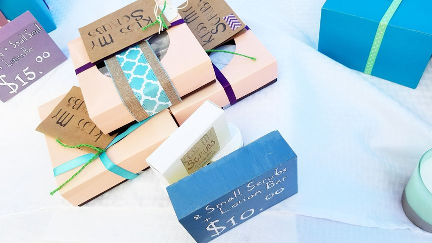 Gift combinations include 2 small scrubs and a lotion bar and 4 small scrubs. Gift boxes have pink...