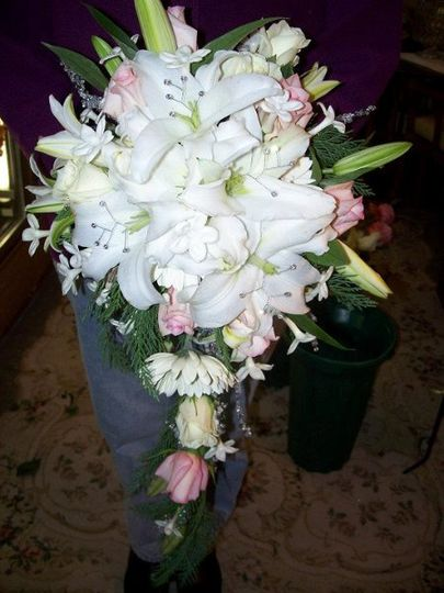 Winter cascade of Casablance Lilies, pink roses and stephanotis.