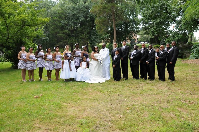 Couple with bridesmaids, flower girls and groomsmen