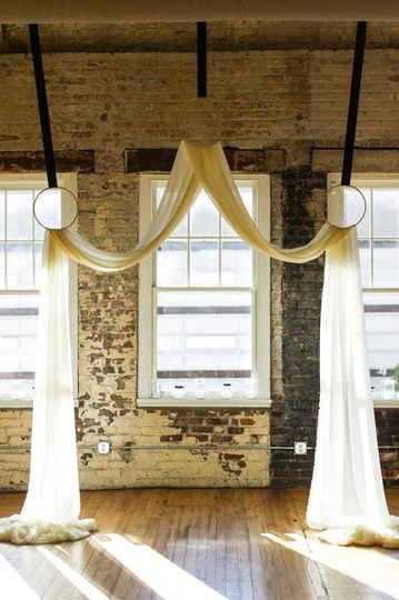 Hanging pipe and drape or rings and drape.