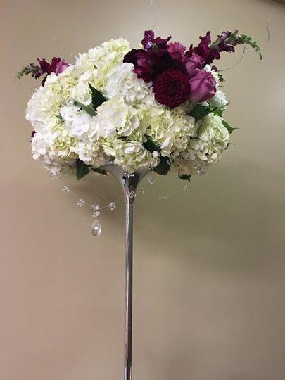 Large arrangement on silver pole.