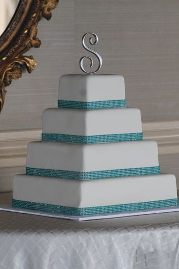 Square wedding cake with blue ribbons
