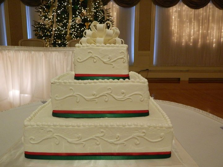 White wedding cake with a bow on top