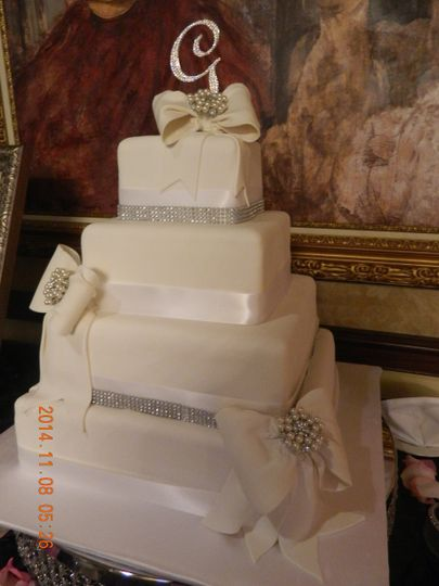 White wedding cake with bits of silver