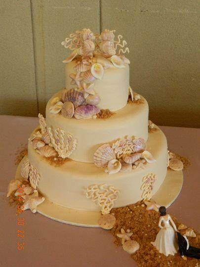 White wedding cake for beach ceremony