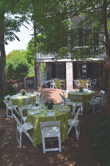 The brick courtyard of the Burgwin-Wright House is a charming environment for luncheons.