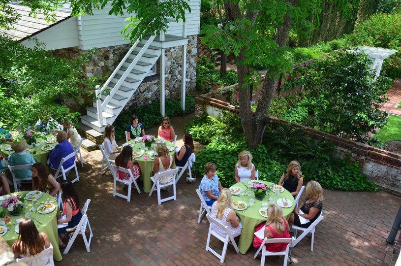 Guests enjoyed appetizers and mimosas in the Burgwin-Wright House orchard before taking their seats...