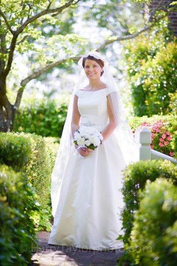 The Burgwin-Wright House gardens offer brides a multitude of beautiful backdrops for portrait...