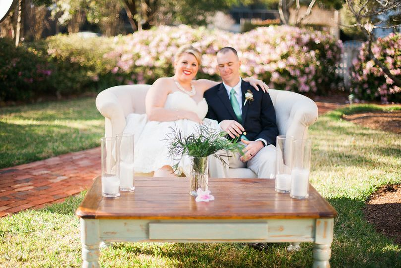 Newlyweds occupy a comfortable love-seat in the orchard of the Burgwin-Wright House gardens.