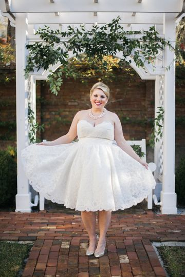 For this bride, the pergola in the Burgwin-Wright House orchard was decorated with additional...