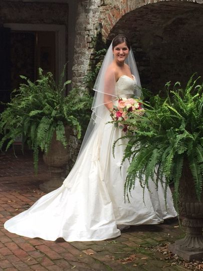A brick vault and a pair of ferns made a beautiful setting for this bride's portrait at the...