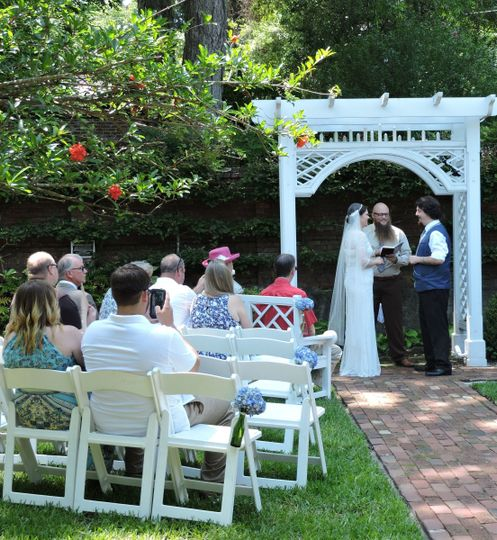Wedding guests enjoy the shade of the pomegranate trees in the orchard of the Burgwin-Wright House....
