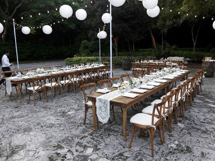 Tables setup with wooden chairs
