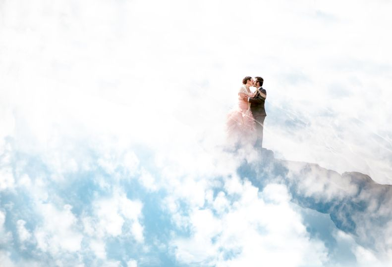 Wedding couple in the clouds