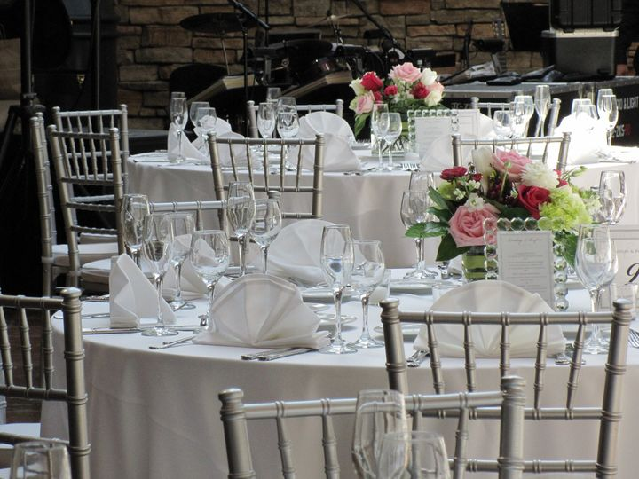 White table setting and floral centerpiece