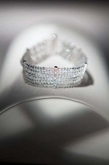 Cassandra Cuff  Six strand crystal bracelet with 5 sterling silver and cubic zirconia spacer bars....
