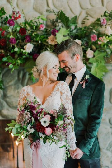 Happy newlyweds surrounded by stunning florals