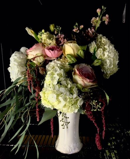 "Garden roses, hydrangeas, and hanging amaranthus for a ""wow"" arrangement"
