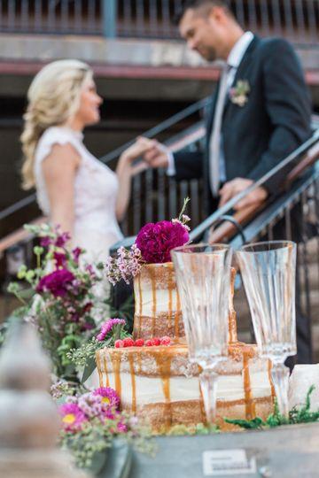 2 layered wedding cake and glasses