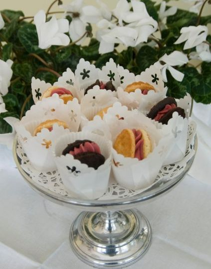 Instead of a boring wedding cake, create a beautiful presentation of individual whoopie pies in...