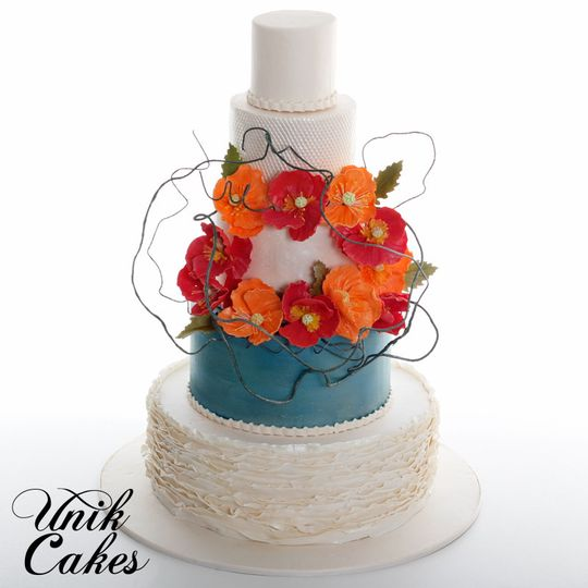 Wedding cake with red and orange flowers