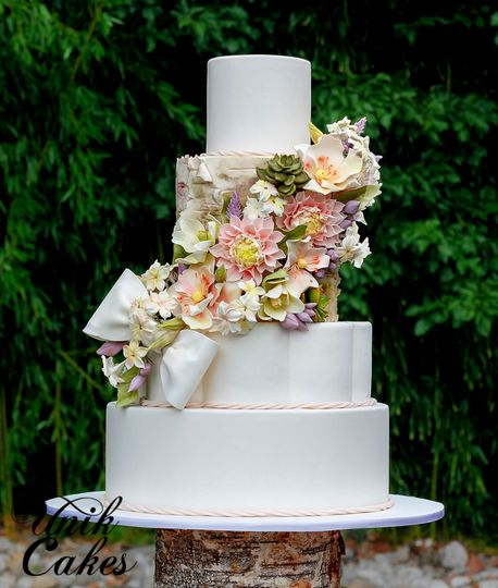 White wedding cake with flower decors
